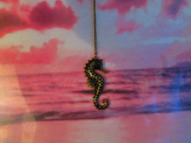 Seahorse with a Peter Lik pastel backdrop